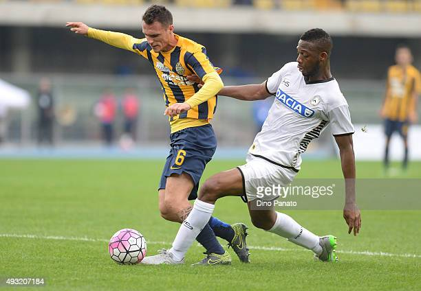 Molla Wague of Udinese Calcio maching penalty foul to Luca Siligardi of Hellas Verona c during the Serie A match between Hellas Verona FC and Udinese...