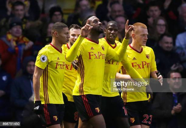Molla Wague of Watford celebrates scoring his team's opening goal during the Premier League match between Watford and Leicester City at Vicarage Road...