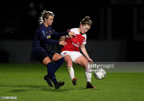 Mollie Green of Manchester United tackles Kim Little of Arsenal during the FA WSL Continental Tyres Cup semi final between Arsenal Women and...