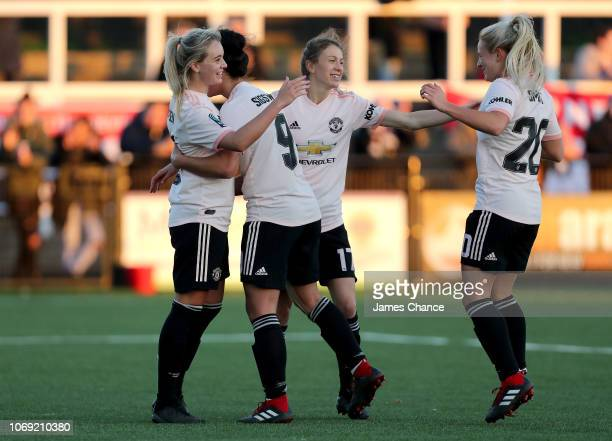 Mollie Green of Manchester United Women celebrates after scoring her team's fifth goal with her team matesduring the FA Women's Championship match...