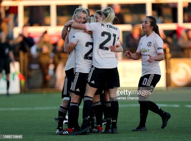 Mollie Green of Manchester United Women celebrates after scoring her team's fifth goal with her team mates during the FA Women's Championship match...