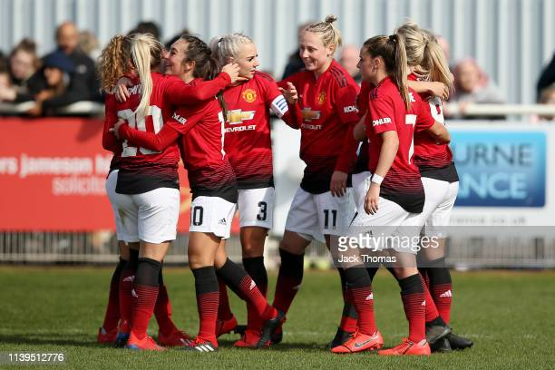 Mollie Green of Manchester United Women celebrates with teammates after scoring her team's third goal during the WSL 2 match between Tottenham...