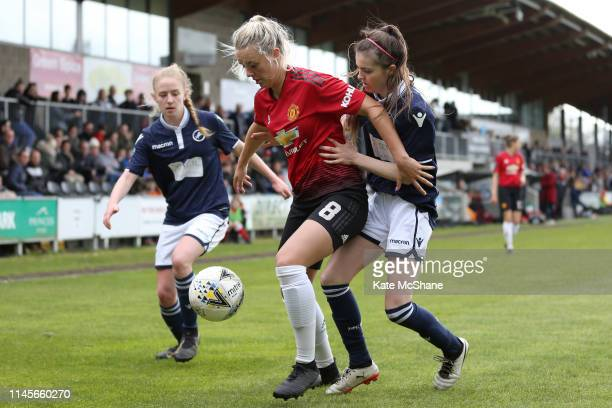 Mollie Green of Manchester United Women is pressured by Lucy Fitzgerald and Chantelle Mackie of Millwall Lionesses during the FA Women's Championship...