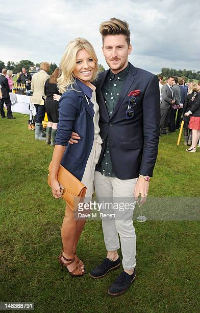 Mollie King and Henry Holland attend the Veuve Clicquot Gold Cup Final at Cowdray Park Polo Club on July 15 2012 in Midhurst England