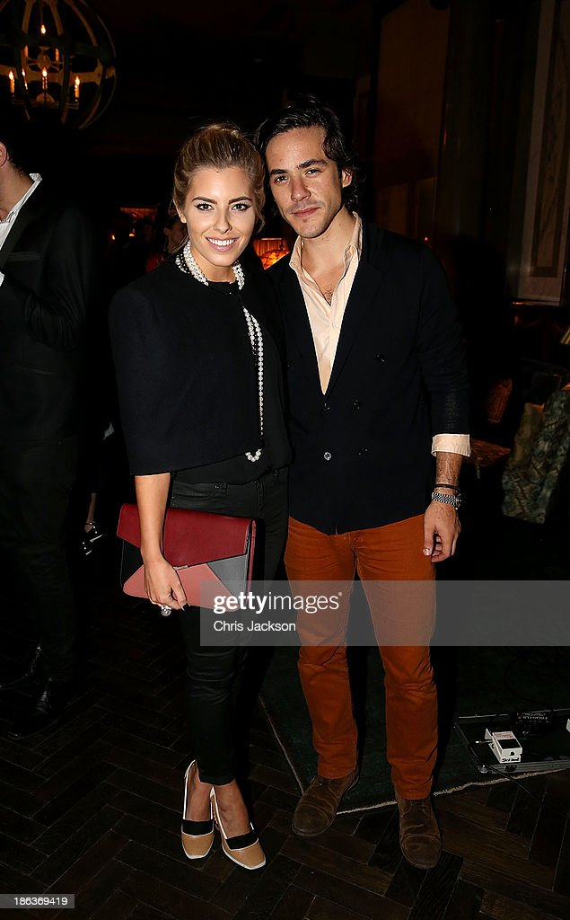 Mollie King and Jack Savoretti attend the opening of Rosewood London on October 30, 2013 in London, England.