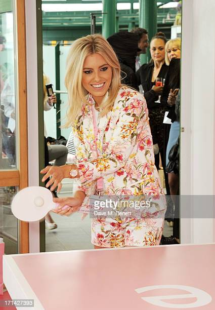 Mollie King plays table tennis at the evian 'Live Young' Suite at Wimbledon on June 24 2013 in London England