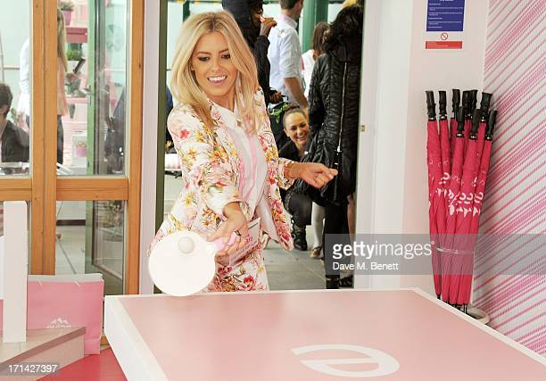 Mollie King plays table tennis at the evian 'Live Young' Suite at Wimbledon on June 24, 2013 in London, England.