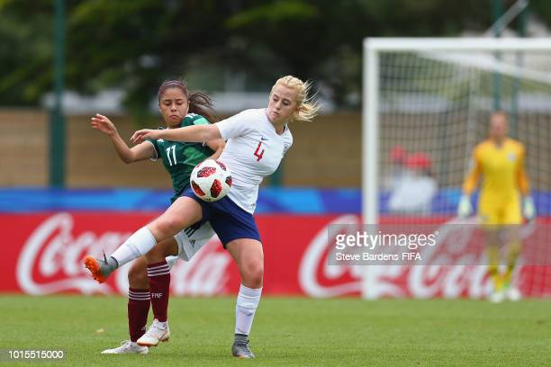 Mollie Rouse of England challenges for the ball with Jacqueline Ovalle of Mexico during the group B match between England and Mexico at Stade de...