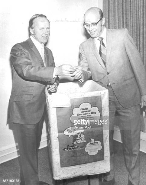 Molly Brown Sweepstakes Winners Selected Edward A Batura left of GanoDowns Co chairman of the promotion committee of the Denver Retail Merchants...
