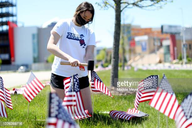 Molly Castle plants a flag outside of Gillette Stadium on May 21 2020 in Foxborough Massachusetts The Patriots foundation partnered with the...