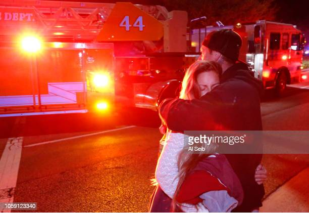 Molly Esterline is hugged by David Crawford on scene after a shooter wounded seven Wednesday night on November 8, 2018 in Thousand Oaks, California....