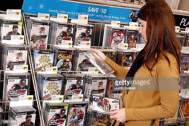 Molly Fitzpatrick shops for video games at a Best Buy store November 26 2002 in Marin City California It is estimated that one third of Americans...