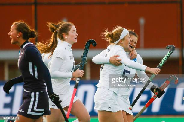 Molly Freeman of Middlebury College embraces teammate Kelly Coyle after Coyle scored during the Division III Women's Field Hockey Championship held...