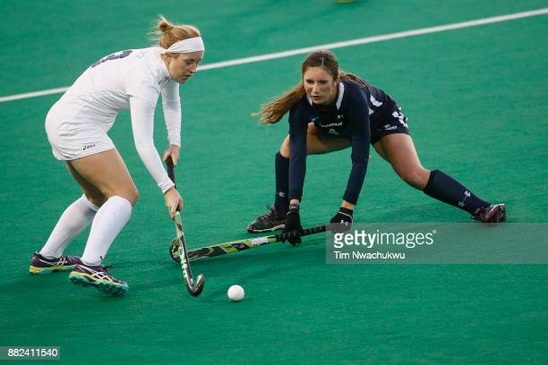 Molly Freeman of Middlebury College tries to dribble the ball past Kaylor Rosenberry of Messiah College during the Division III Women's Field Hockey...