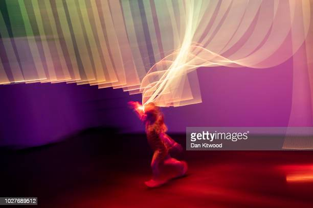 Molly from Brighton plays inside an artwork entitled 'Australia Full Spectrum' by designers Flynn Talbot Ltd during the 'London Design Biennale' at...
