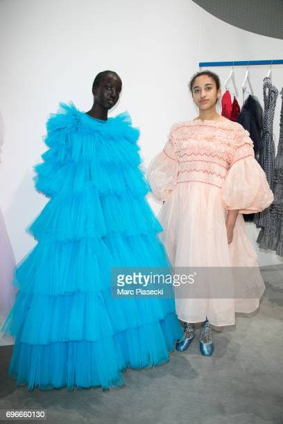 'Molly Goddard' models pose during the 'Young Fashion Designer' LVMH prize 2017 at Fondation Louis Vuitton on June 16 2017 in Paris France