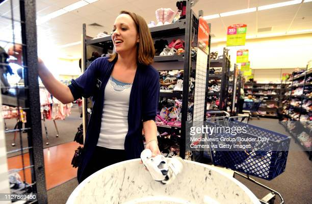 Molly Hanson of the shoe department organizes kid's shoes at the Nordstrom Rack store on May 14 2010The Nordstrom Rack retail store in Broomfield is...