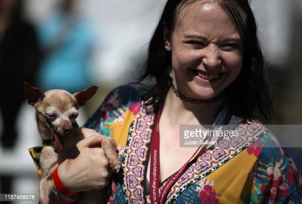Molly Horgan holds her dog Tostito before the start of the World's Ugliest Dog contest at the MarinSonoma County Fair on June 21 2019 in Petaluma...