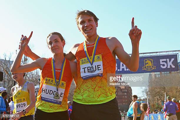 Molly Huddle and Ben True, both of the United States, celebrate after winning the B.A.A. 5k on April 18, 2015 in Boston, Massachusetts.