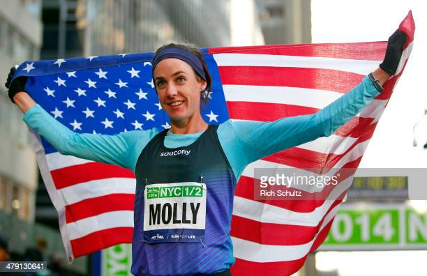 Molly Huddle holds the flag as she is finished third and was the top American runner in the 2014 New York City Half Marathon in lower Manhattan on...