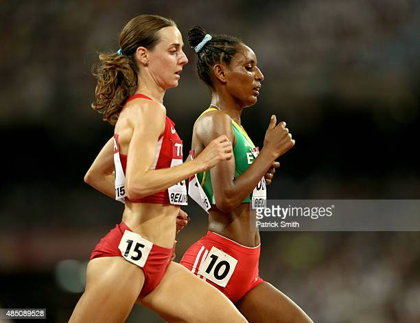 Molly Huddle of the United States and Belaynesh Oljira of Ethiopia compete in the Women's 10000 metres final during day three of the 15th IAAF World...