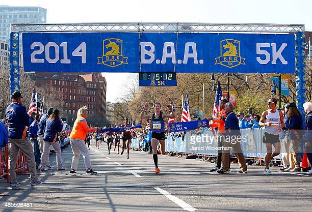 Molly Huddle of the United States crosses the finish line to finish in first place in the women's field during the 2014 B.A.A. 5K on April 19, 2014...