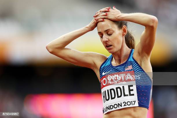 Molly Huddle of United States holds her head in her hands in reaction after the womens 5000 metres heats during day seven of the 16th IAAF World...