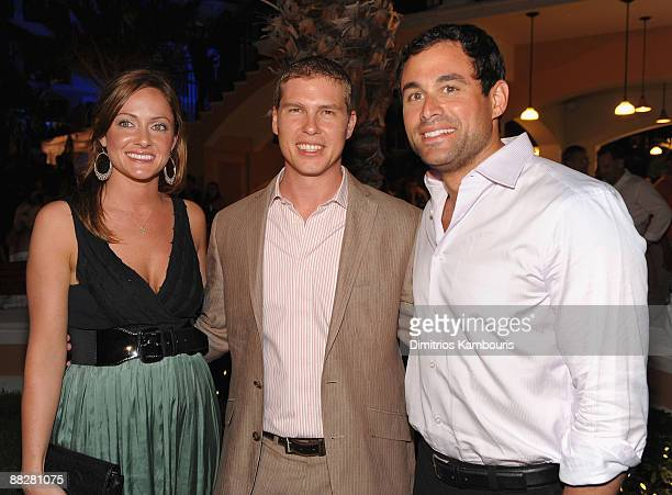 PROVIDENCIALES TURKS AND CAICOS ISLANDS MAY 16 Molly Malaney Adam Stewart and Jason Mesnick attend the grand opening of Italian Village Pirates...