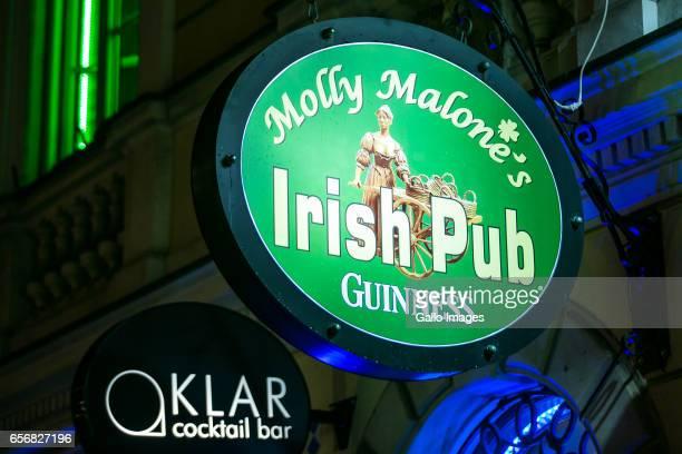 Molly Malone's Irish Pub pub light seen during Saint Patricks Day celebration on March 17, 2017 in Warsaw, Poland. Saint Patricks Day is a cultural...