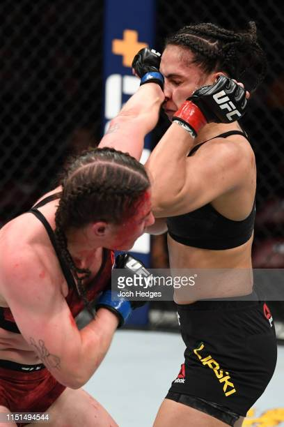 Molly McCann of England punches Ariane Lipski of Brazil in their women's flyweight bout during the UFC Fight Night event at Bon Secours Wellness...