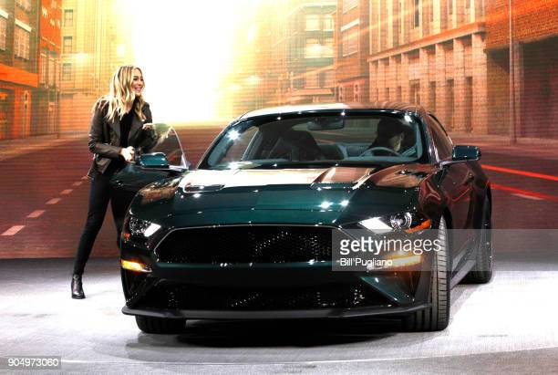 Molly McQueen the granddaughter of actor Steve McQueen gets out of the new 2018 Ford Mustang Bullitt at its debut at the 2018 North American...