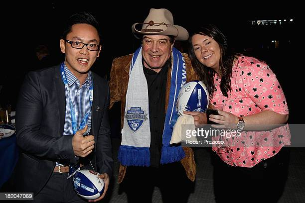 Molly Meldrum poses for photos with fans during the 2013 Blackwoods North Melbourne Grand Final Breakfast at Etihad Stadium on September 28 2013 in...