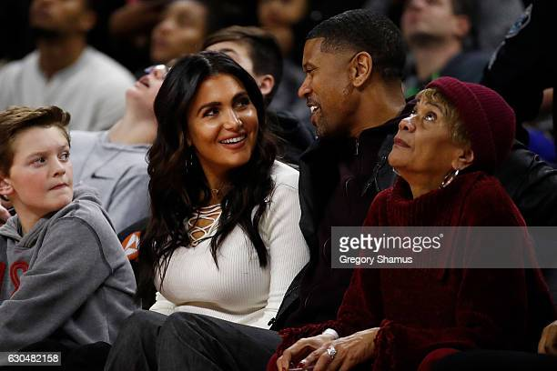 Molly Qerim and Jalen Rose of ESPN watch the Golden State Warriors play the Golden State Warriors at the Palace of Auburn Hills on December 23 2016...