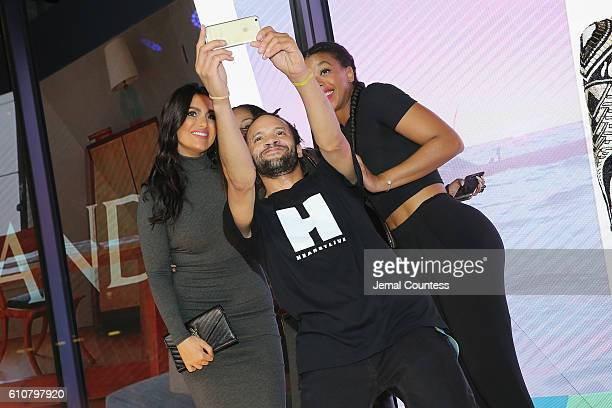 Molly Qerim and Savion Glover take a selfie during the Hearst launch of HearstLive a multimedia news installation at 57th Street 8th Avenue on...