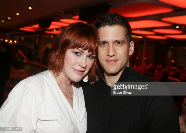 Molly Ringwald and husband Panio Gianopoulos pose at the opening night party for the new musical Bob Carol Ted Alice at Green Fig Urban Eatery at...