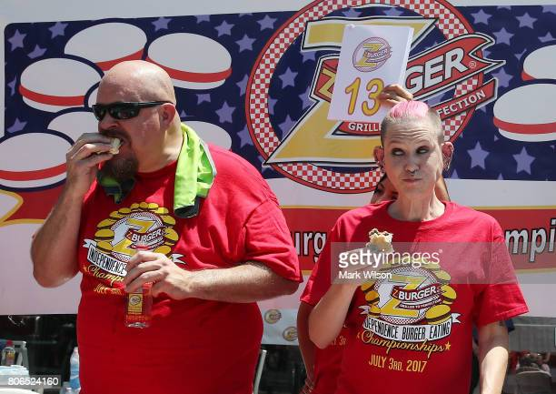 Molly Schuyler who is ranked competitive eater in the world along with Bob 'Notorious BOB' Shoudt eat hamburger's during Z Burger's eighth annual...