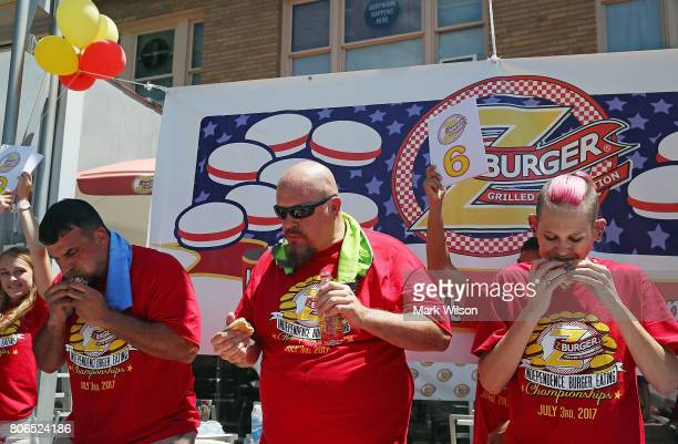Molly Schuyler who is ranked competitive eater in the world along with Bob 'Notorious BOB' Shoudt and David 'Tiger Wings and Things' Brunelli eat...