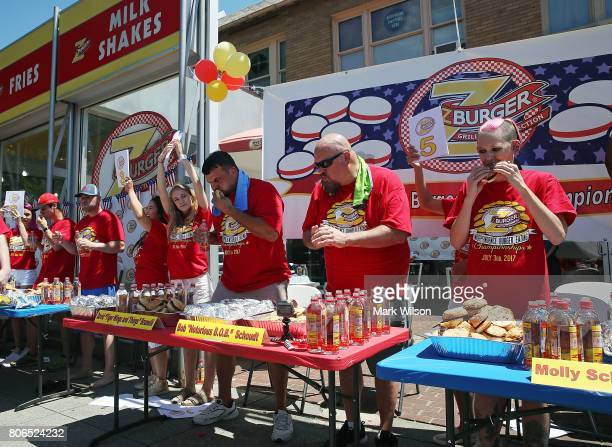 Molly Schuyler who is ranked competitive eater in the world eats a hamburger's during Z Burger's eighth annual Independence Burger Eating...