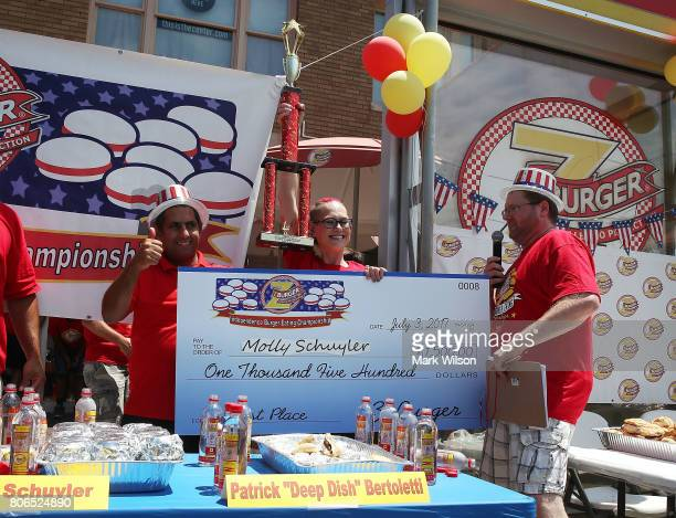 Molly Schuyler who is ranked competitive eater in the world is given a trophy and a check for fiftheen hundred dollars during Z Burger's eighth...