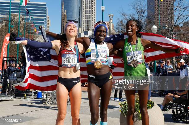 Molly Seidel Aliphine Tuliamuk and Sally Kipyego pose after finishing in the top three of the Women's US Olympic marathon team trials on February 29...