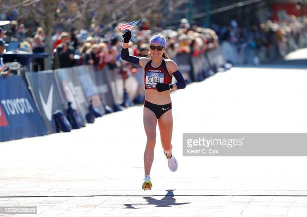 Molly Seidel reacts as she crosses the finish line in second play during the Women's US Olympic marathon team trials on February 29 2020 in Atlanta...