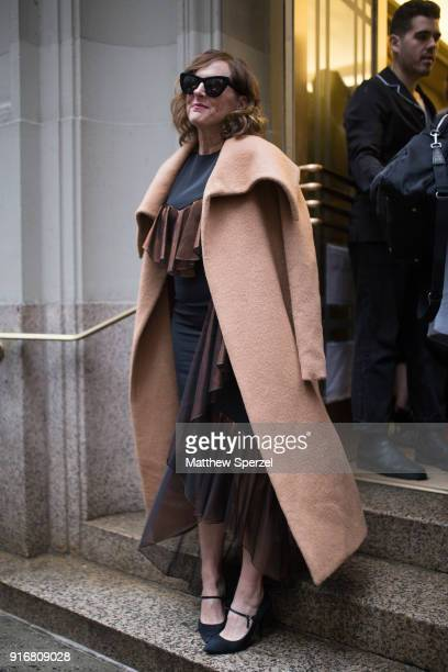 Molly Shannon is seen on the street attending Christian Siriano during New York Fashion Week wearing Christian Siriano with camel wool coat on...
