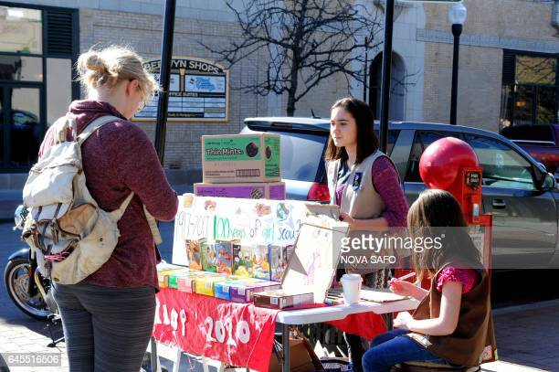 Molly Sheridan age 13, and her sister Edie, age 5, sell Girl Scout cookies in Chicago on February 19, 2017. On a sunny Sunday afternoon, Molly...