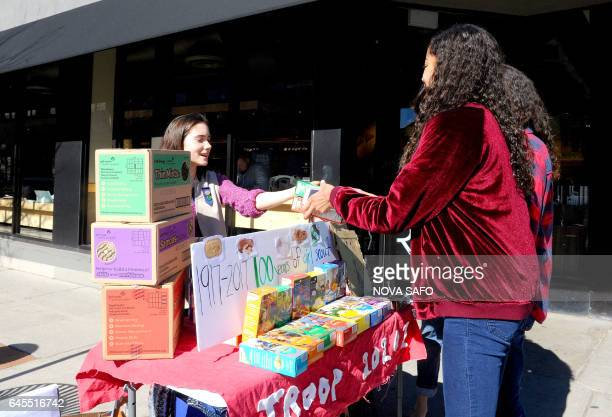 Molly Sheridan age 13, sells Girl Scout cookies in Chicago on February 19, 2017. On a sunny Sunday afternoon, Molly Sheridan is hard at work in front...