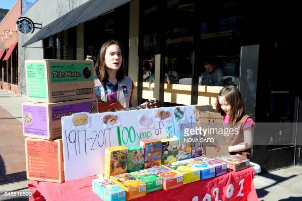 Molly Sheridan age 13, sings with her ukulele as she and her sister Edie age 5, sell Girl Scout cookies in Chicago on February 19, 2017. On a sunny...