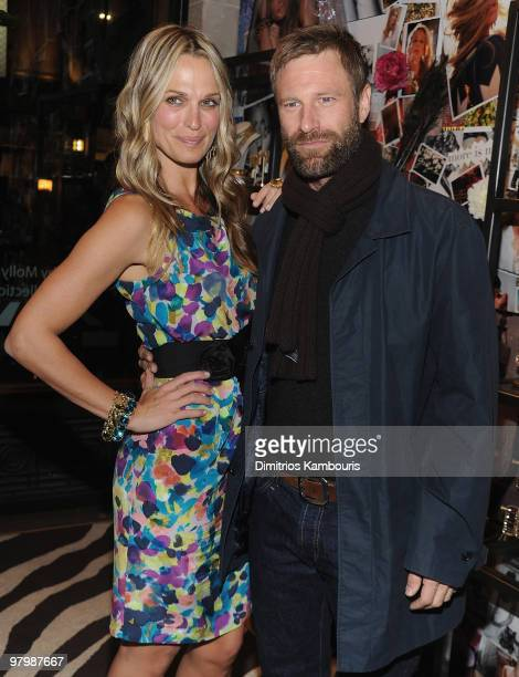 Molly Sims and Aaron Eckhart attend the 'Grayce by Molly Sims the Collection' launch at Henri Bendel on March 23 2010 in New York City