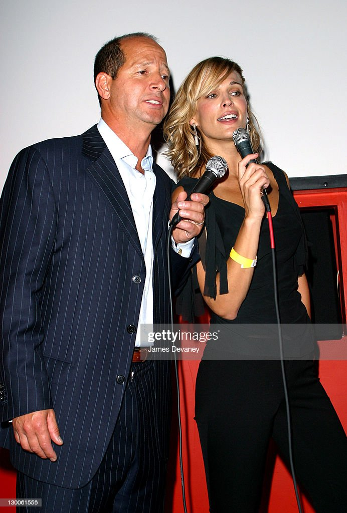 Molly Sims and GQ publisher Ron Galotti singing karaoke