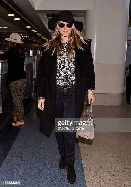 Molly Sims is seen at LAX airport on January 27 2014 in Los Angeles California