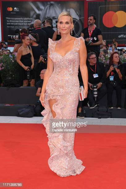 Molly Sims walks the red carpet ahead of the Joker screening during the 76th Venice Film Festival at Sala Grande on August 31 2019 in Venice Italy