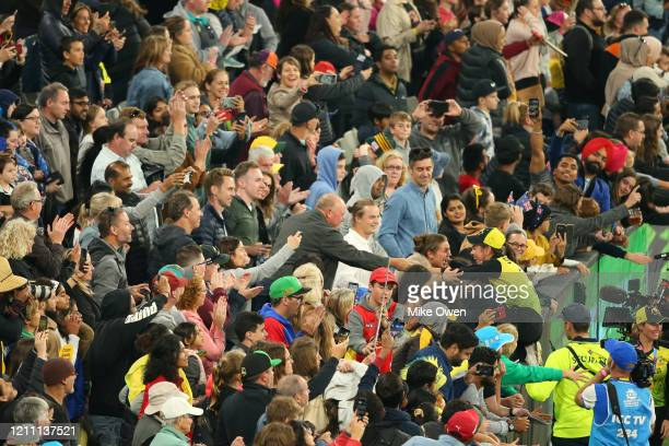 Molly Strano climbs into the crowd after the ICC Women's T20 Cricket World Cup Final match between India and Australia at the Melbourne Cricket...